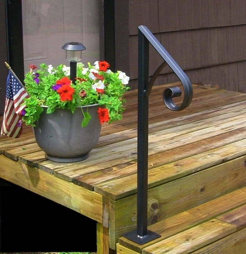 A tall example of indoor and outdoor handrails on a wooden front porch